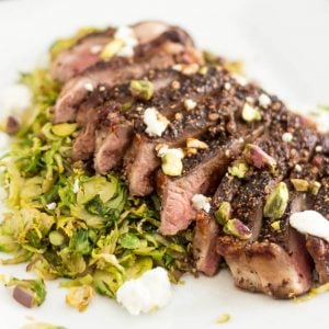 Crusted Strip Steak over Warm Shaved Brussels Sprouts