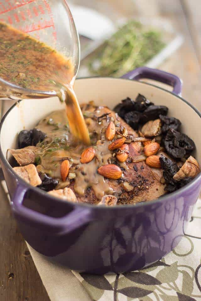 Braised Leg of Lamb with Dried Prunes and Toasted Almonds | thehealthyfoodie.com