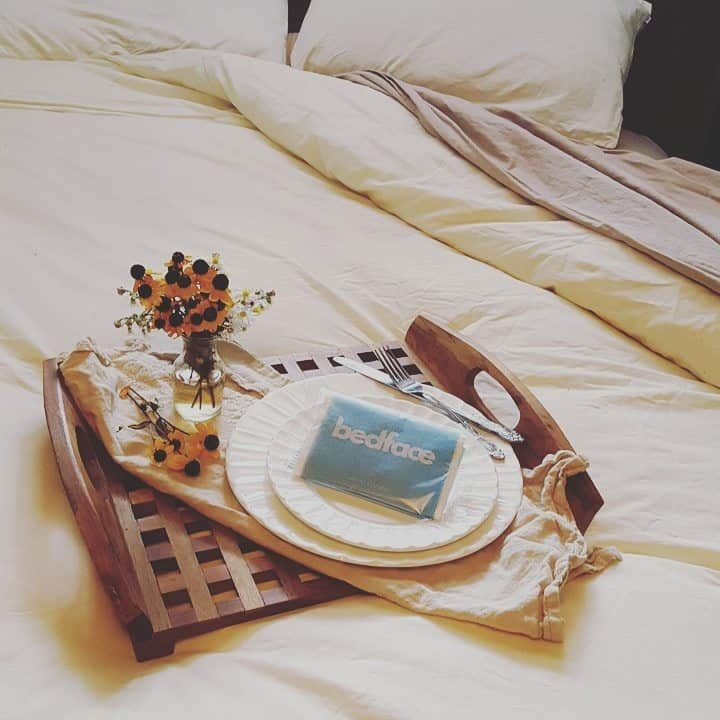 Breakfast in bed with bedface sheets
