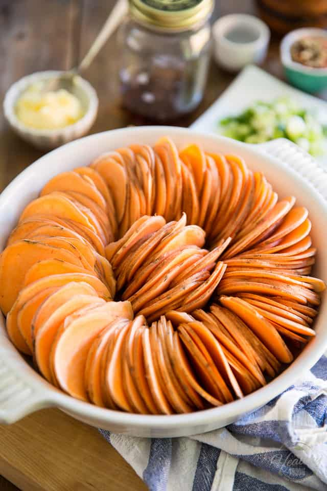 This elegant Scalloped Sweet Potato Ring is much easier to make than you may think and is so incredibly good, it's the perfect sweet potato recipe for any occasion!