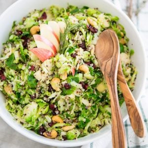 This Apple Cranberry Cashew Shaved Brussels Sprouts Quinoa Salad is super delicious and can be made days in advance. You'll love having it in the fridge.