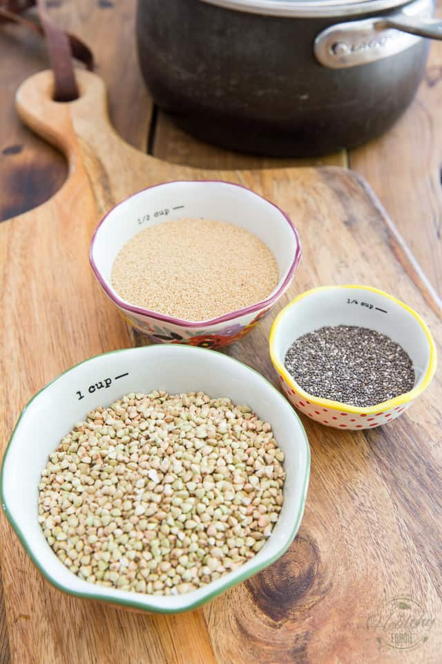 Overhead view of raw buckwheat amaranth and chia in little individual bowls