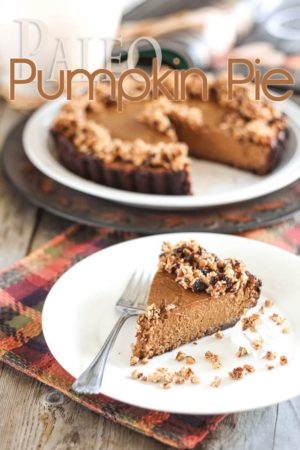 Paleo Pumpkin Pie heaven is here! A devilishly rich and spicy custard-like filling in a tender, crispy crust, topped with a crunchy honey sweetened crumble.
