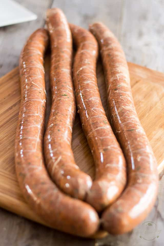 Homemade Italian Sausage being twisted and separated into individual links