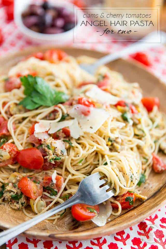 Exploding with so much flavor but ready in mere minutes, this simple yet sophisticated Clams and Cherry Tomatoes Angel Hair Pasta dish is the perfect choice for your next quick and casual romantic dinner for two...