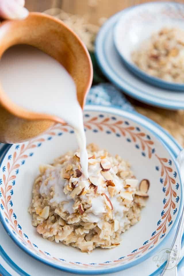 Milk is being poured over a bowl of Toasted Coconut and Almond Oatmeal