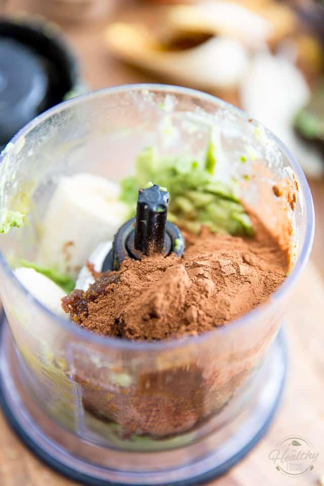 A food processor containing avocado, bananas and cacao powder