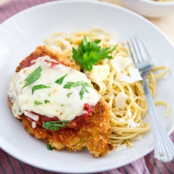 This Chicken Parmigiana is proof that Comforting food doesn't necessarily have to be bad for you... serve it with a side of your favorite pasta to keep with the classic, or opt for sauteed veggies or a green salad for an even lighter version!