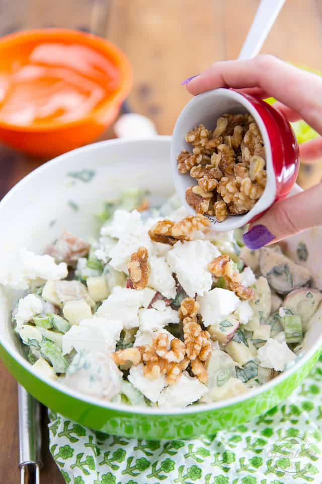 Walnuts are being added to a creamy Apple Feta Potato Salad