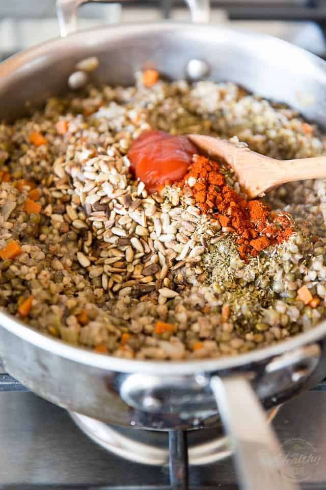 Spices are getting mixed into cooked lentils and kasha in a saute pan