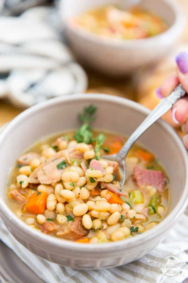 With its generous chunks of carrots, celery, loads of navy beans and cubed ham, this White Bean and Smoked Ham Soup is as hearty and nutritious as can be! The perfect way to warm you up on a chilly day, or to use up your leftover ham!