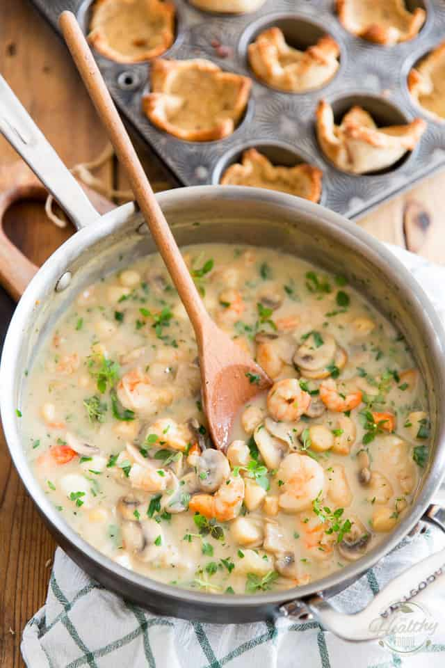 Rich and creamy Seafood Sauce for Seafood Toast Cups sitting in a stainless steel saute pan