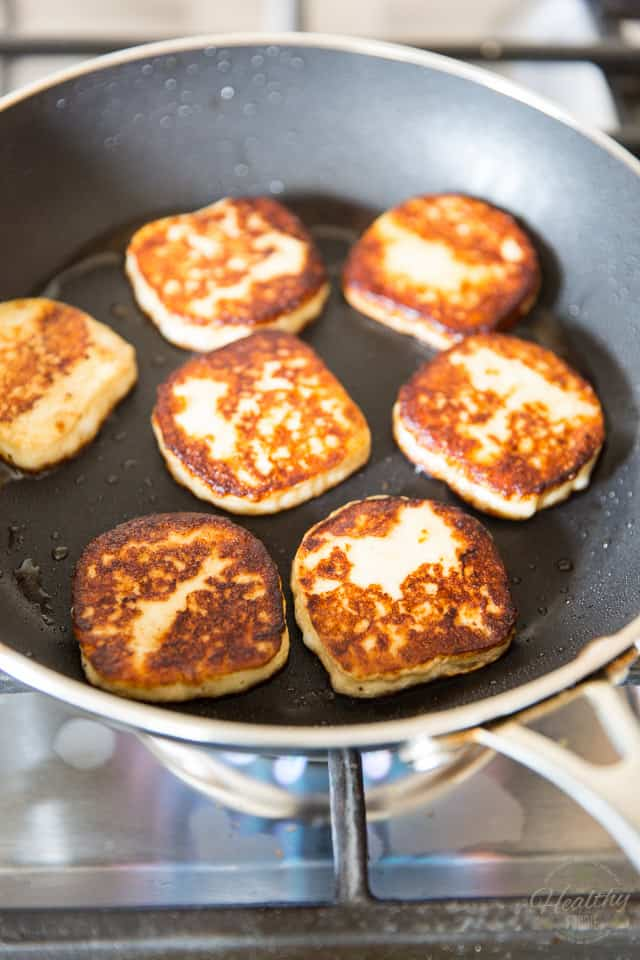 Slices of grilled halloumi in a non-stick pan
