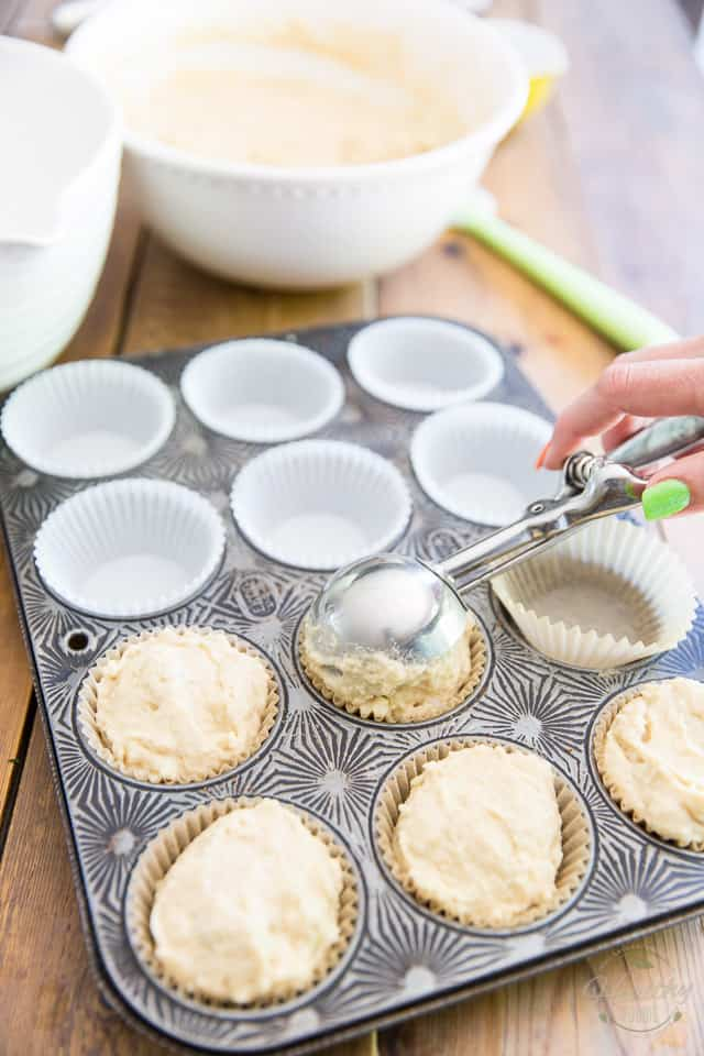 Muffin batter getting divided between cups of muffin pan