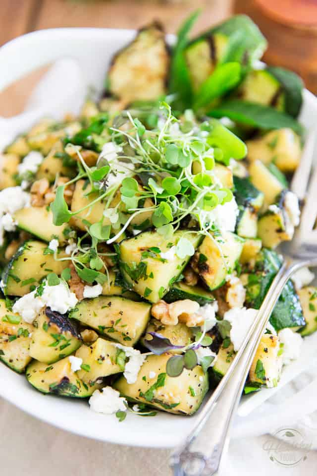 Buried under zucchini? This Grilled Zucchini Salad sure is a different and tasty way to make good use of them! In fact, it'll probably have you want to go out and get more!