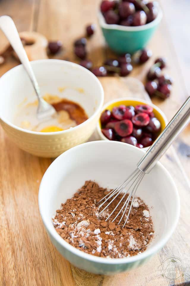 Dry and wet ingredients to make cake in separate bowls