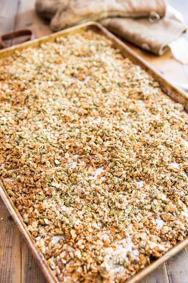 Granola fresh out of the oven on large baking sheet