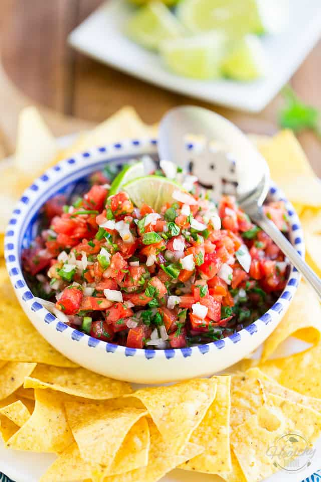Pico de Gallo is a crazy tasty yet super simple Mexican salsa made from chopped tomatoes, onion, cilantro, fresh jalapenos, salt, and lime juice. Serve it with tortillas or sprinkle liberally on all your favorite foods!
