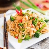 This spicy peanut chicken noodle dish is loaded with tasty morsels of chicken, crunchy veggies and soft rice noodles, all wrapped up in a rich and spicy peanut sauce.