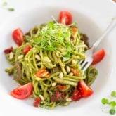 Arugula Pesto is a very decent, super tasty and much more affordable alternative to traditional basil pesto! Served with pasta, paired with sun dried tomatoes and pine nuts, it makes for a truly winning combination.