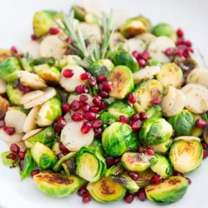 Looking for a festive and delicious yet super healthy side dish this Christmas? Look no further! These Pan Roasted Brussels Sprouts with Water Chestnuts and Pomegranate Seeds are sure to be a hit!