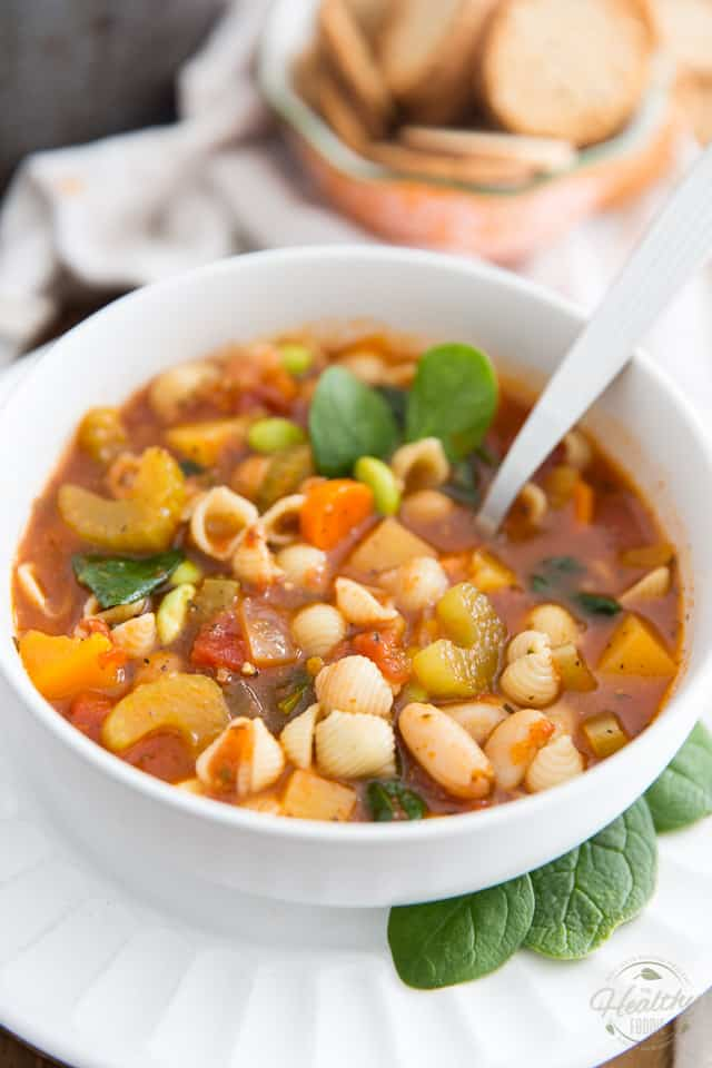 Loaded with all kinds of healthy vegetables and hearty beans, simmered in a rich, herby tomato broth, this Vegan Minestrone Soup is the perfect hearty meal to warm you up, inside and out! .