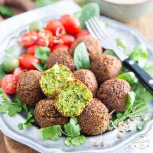Homemade Falafel is SO much better! Learn how to make this deliciously crispy, light and fluffy chickpea fritter the right way, from scratch, with good wholesome and nutritious ingredients! It's much easier than you think!