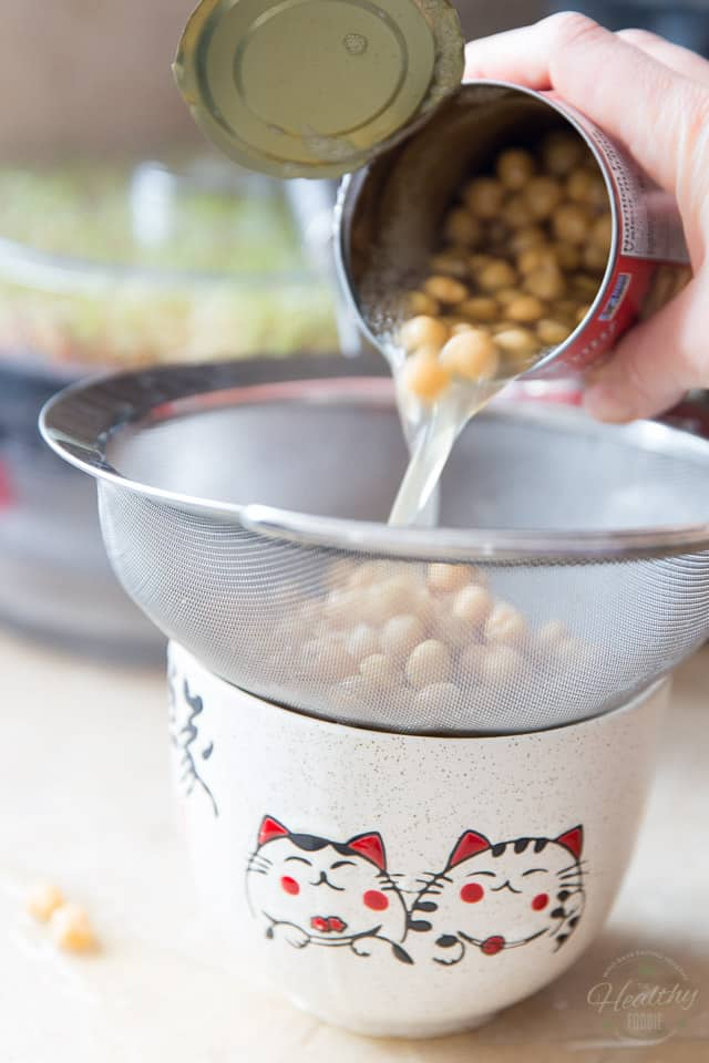Draining chickpeas in a fine meshed sieve