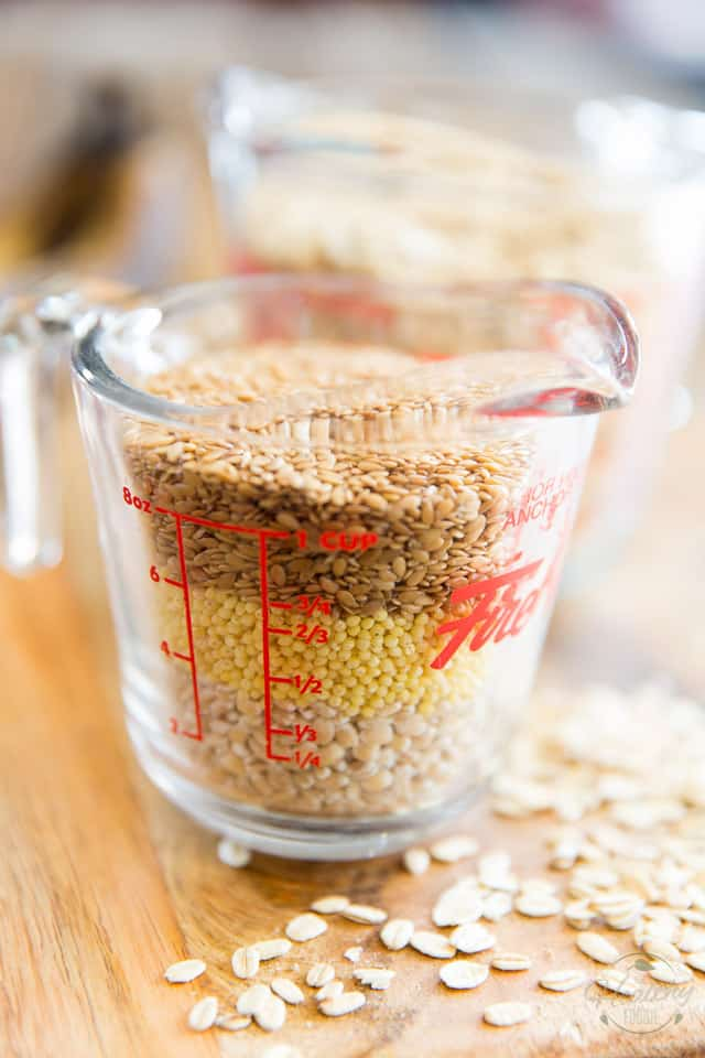 Barley, Millet and Flax Seeds in a glass measuring cup