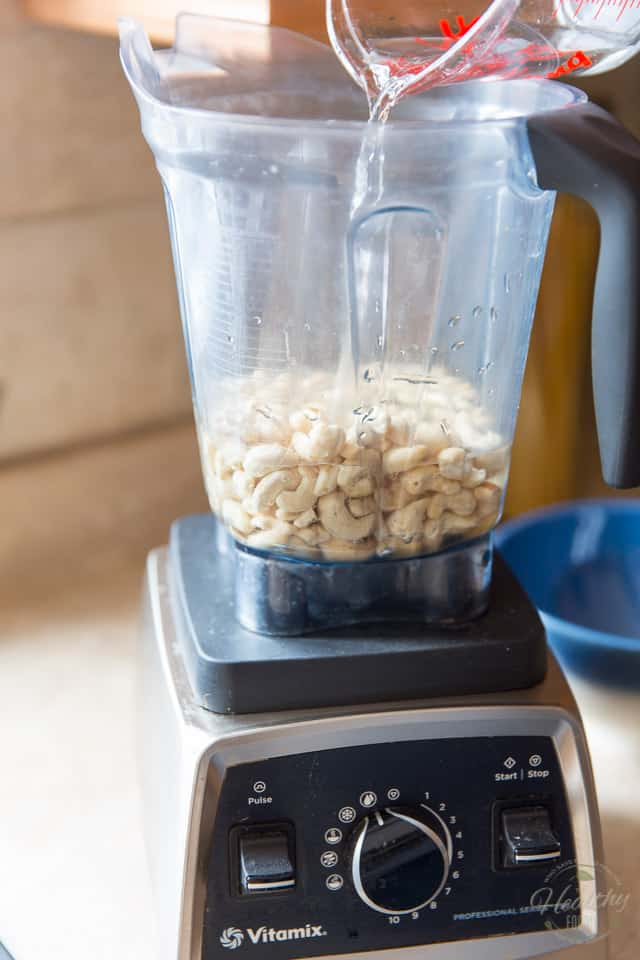 Place the cashews and water in the container of a high speed blender