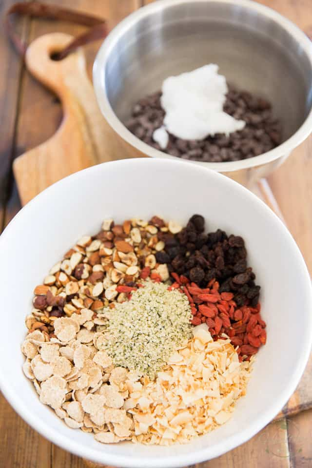 Mise en place: the nuts and cereal in one bowl, chocolate chips and coconut oil in a separate bowl