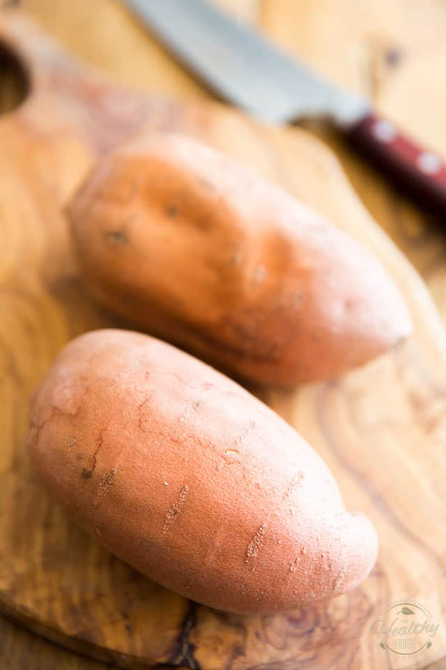 Sweet potatoes on a wooden cutting board