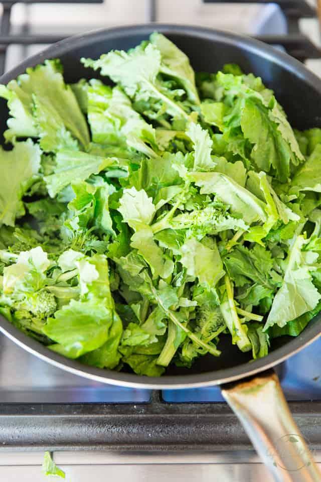Add the raw rapini to the frying pan