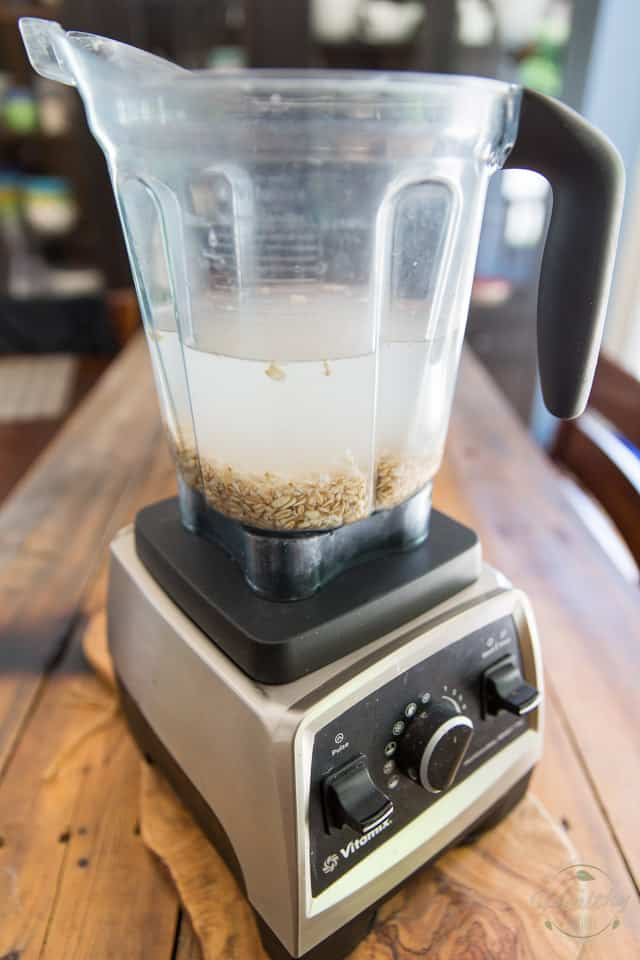Place oats and water in the container of your high speed blender