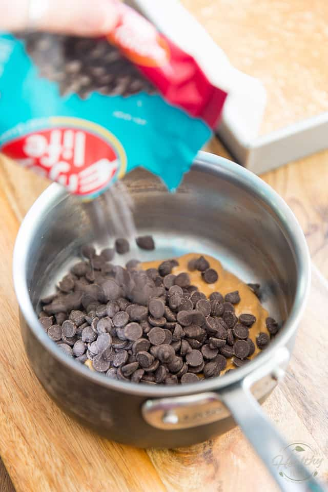 Combine peanut butter and chocolate chips into small saucepan