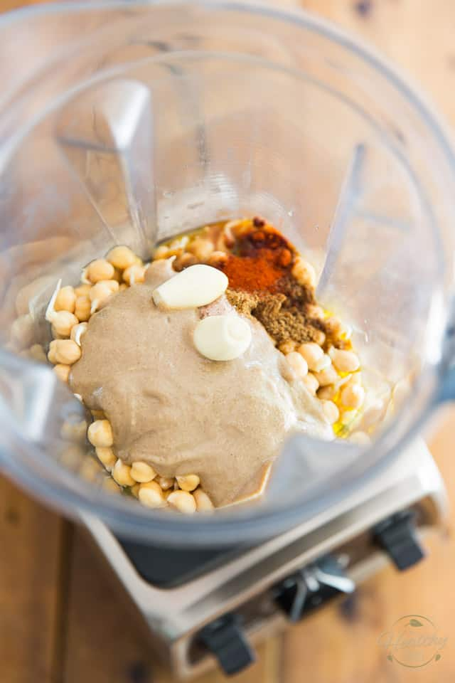 All the ingredients to make hummus in container of high speed blender