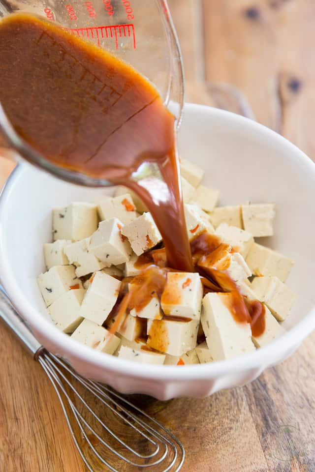 Place cubed tofu in a bowl and pour marinade over it