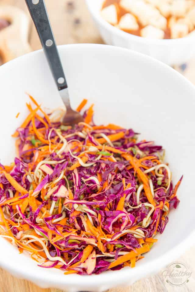 Combine all ingredients for the slaw in a bowl and mix well