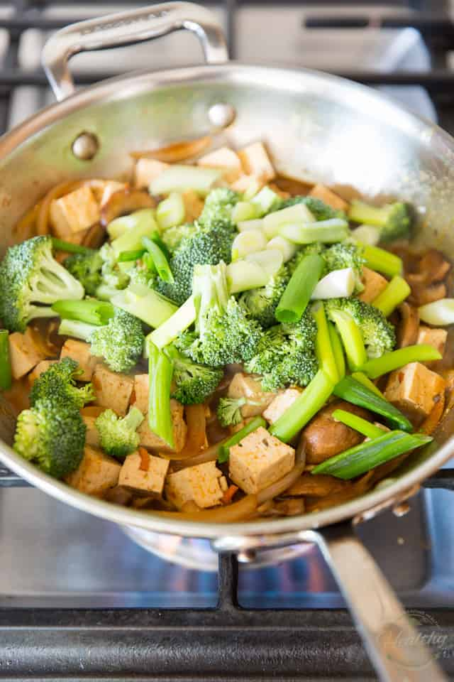 Add the broccoli and green onions to the pan