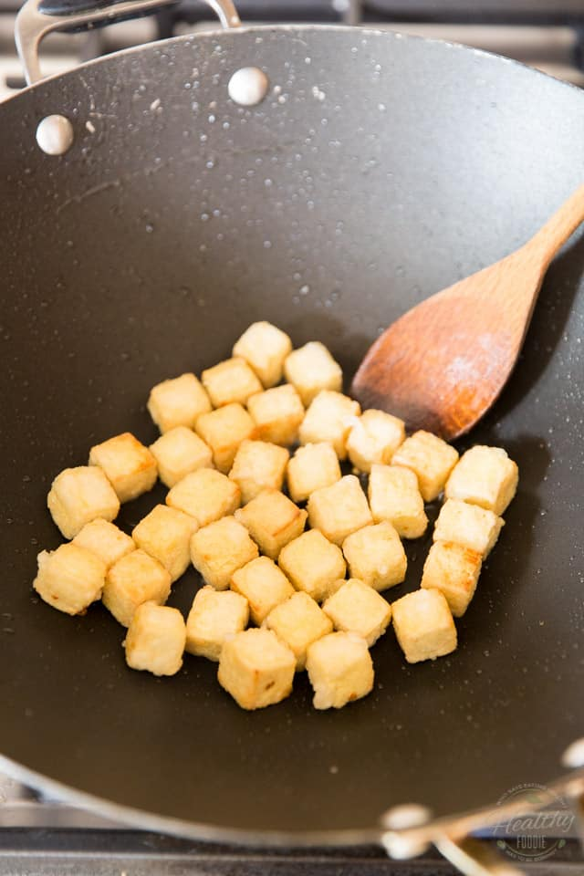 Cook the tofu in hot saute pan or wok