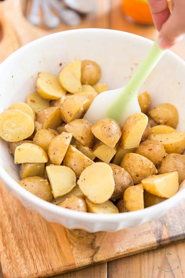 Give the potatoes a delicate stir to coat them in the dressing
