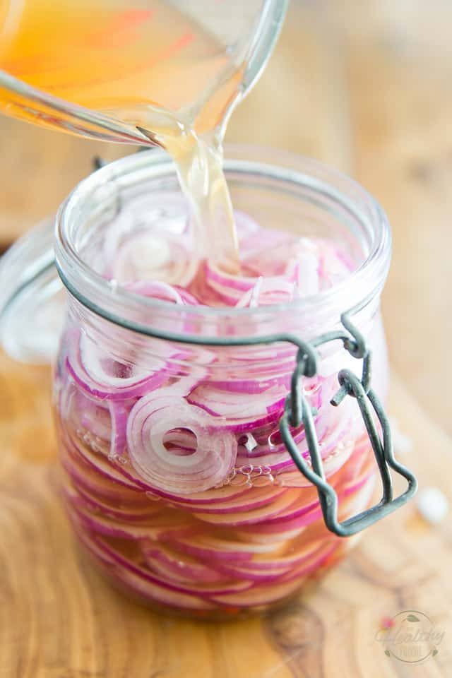 Pour the pickling brine over the sliced onions