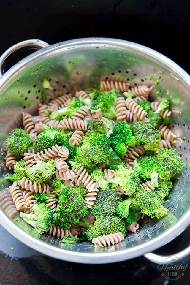 The broccoli and pasta in a large colander