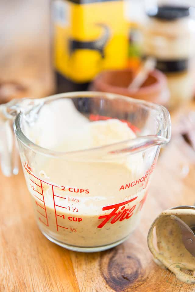 Process until thick and creamy and pour into cruet or other glass container