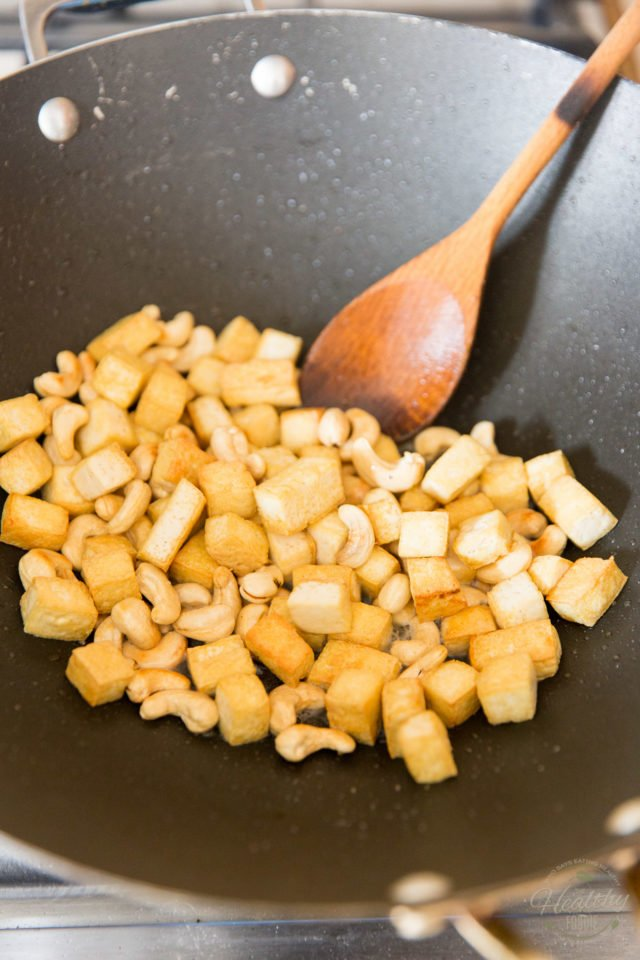 Continue cooking until the cashews turn golden and fragrant