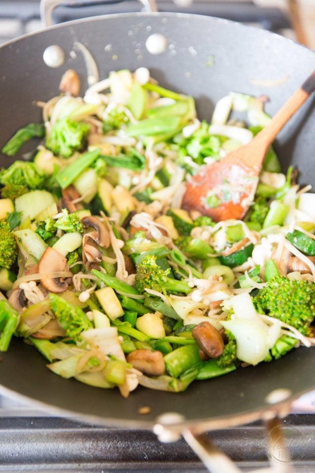 Add the sugar snap peas, enoki and green onions