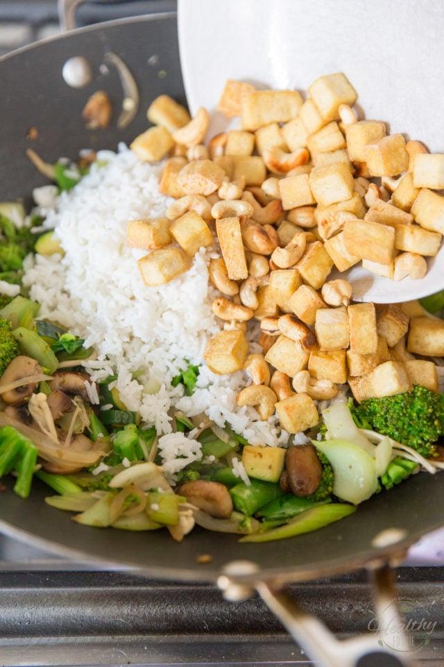 Add rice, seasonings and return tofu and cashews to wok