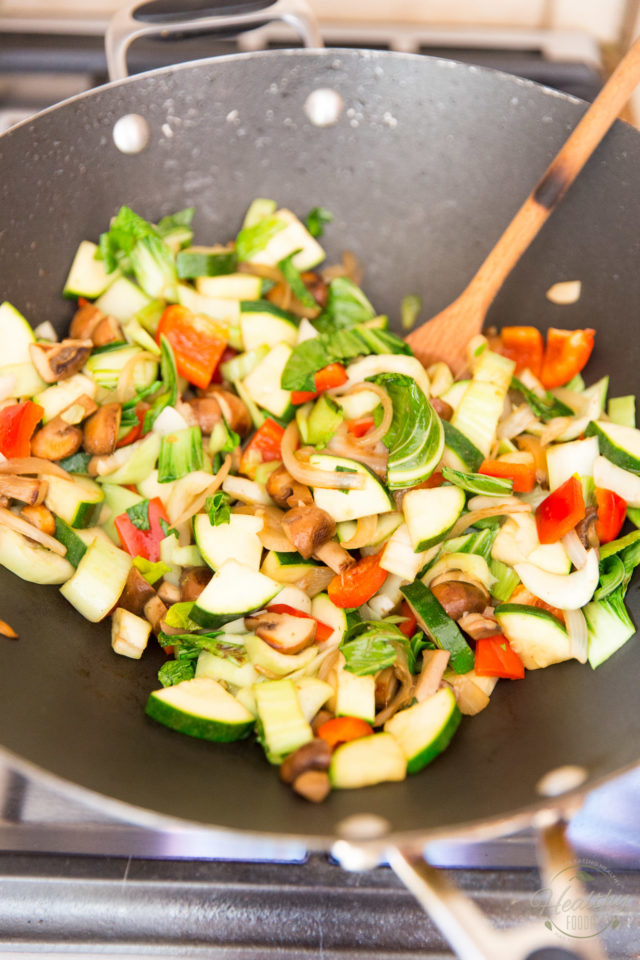 Adding zukes, bok choy and red bell peppers to the wok