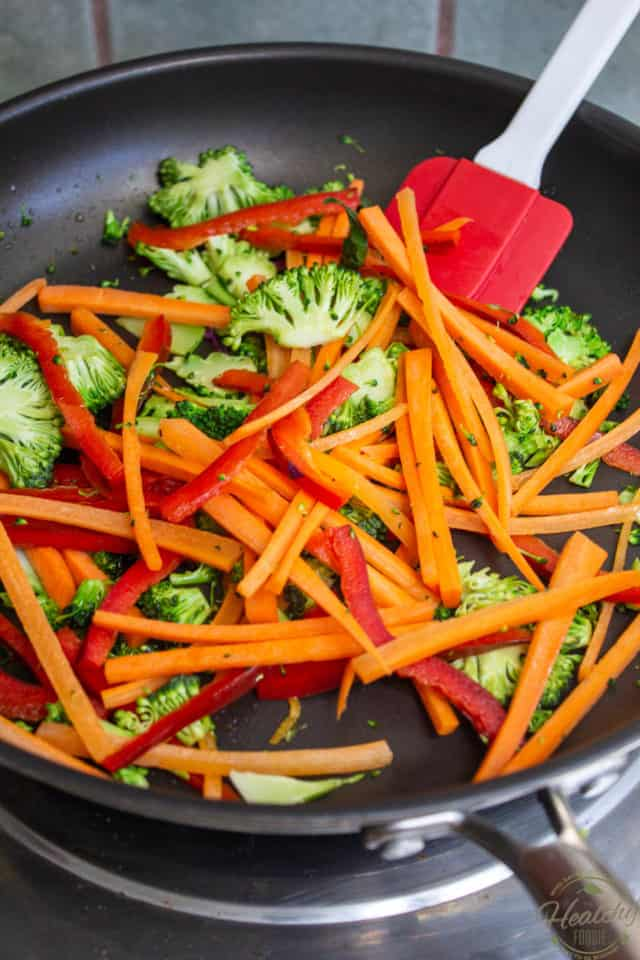 Cook the carrots, peppers and broccoli in a large saute pan for about 1 minute