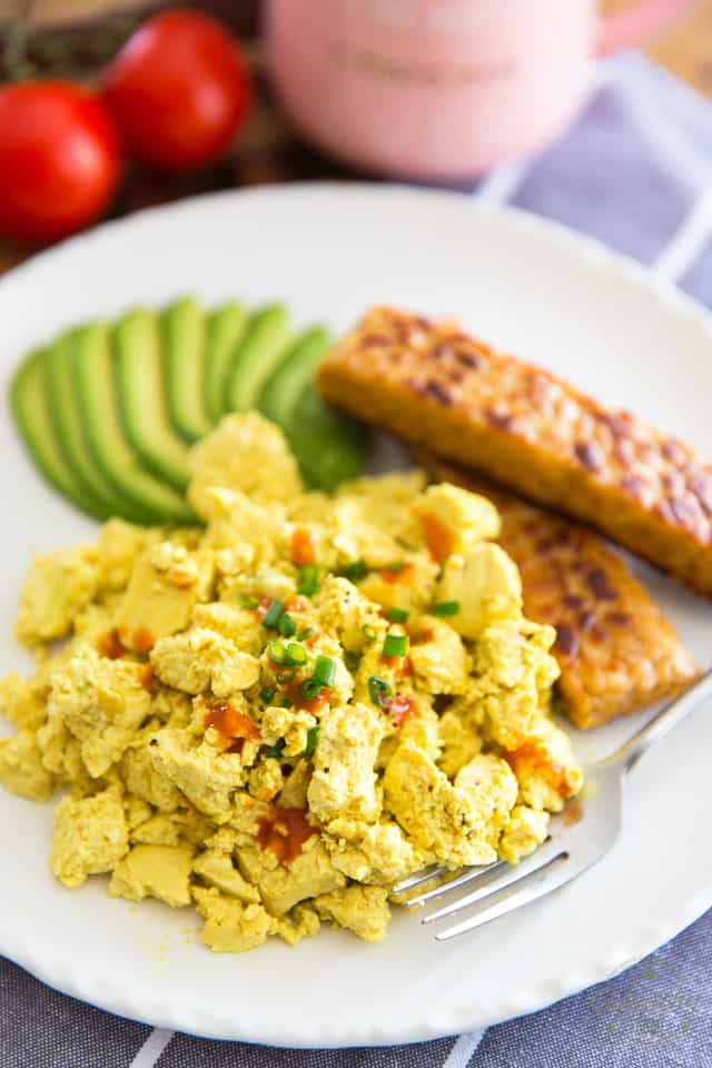 A quick, easy and delicious vegan alternative to Scrambled Eggs, this Eggy Tofu Scramble truly is the ultimate replacement. In fact, it's so good you might even prefer it to the real deal!